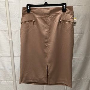 nude knee length skirt with zipper pockets.